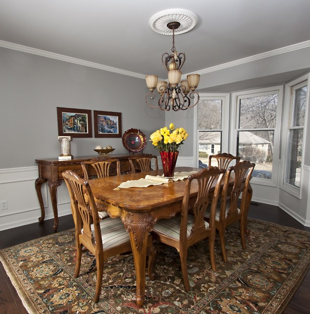 Crown molding, wainscoting, ceiling medallion, hand-knotted Indian rug, with country French furniture.
