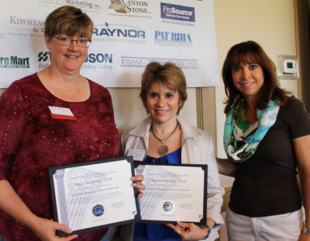 Melody Davidson receiving her Universal Design Certified Professional certificate